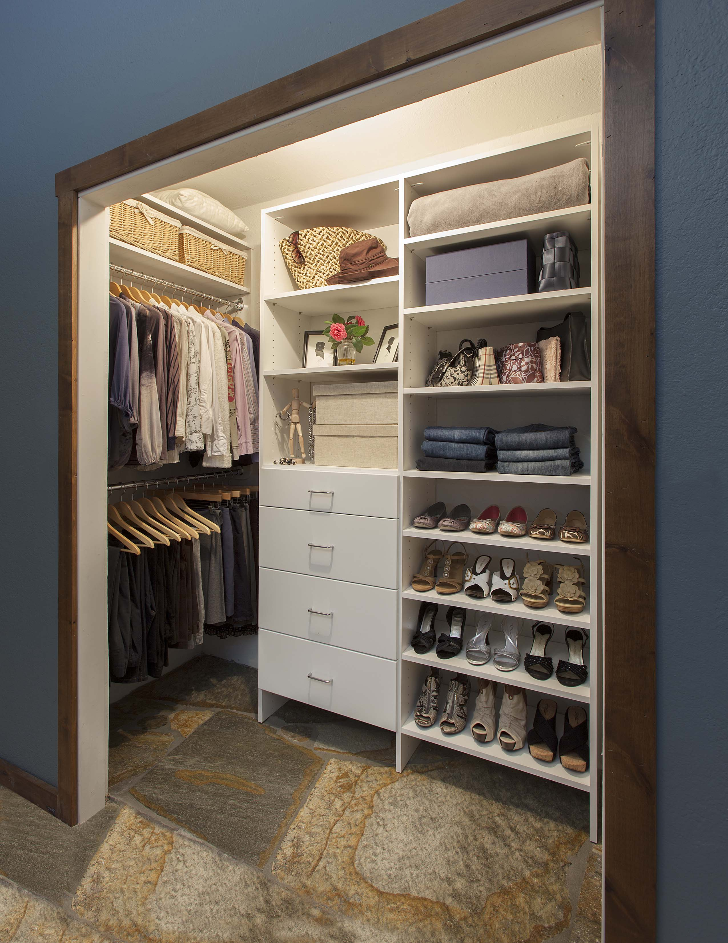 Reach-in Closet with Hanging Rods on Side Walls