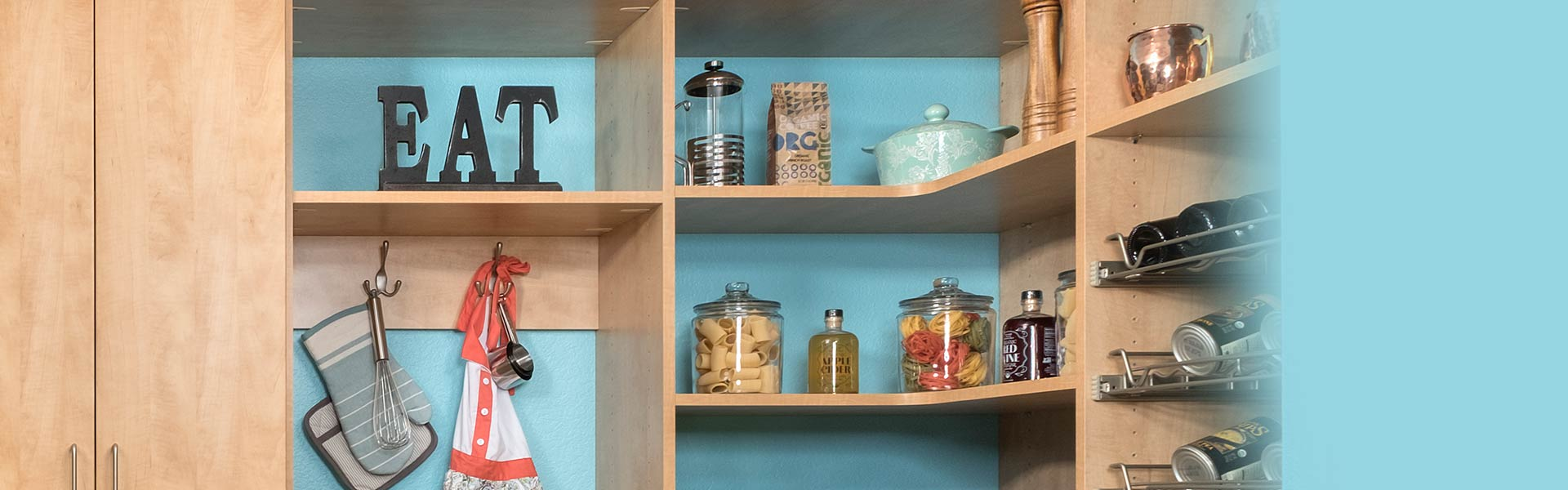 Secret pantry with modern cabinets and adjustable shelves