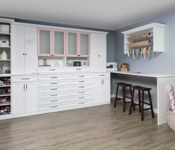 White and blush cabinet installation in a craft room.