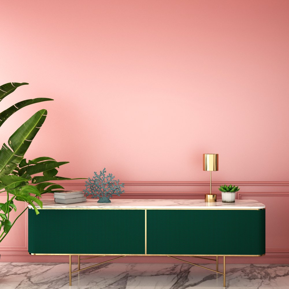 Colorful interior design for a living area with a pink wall and green credenza.