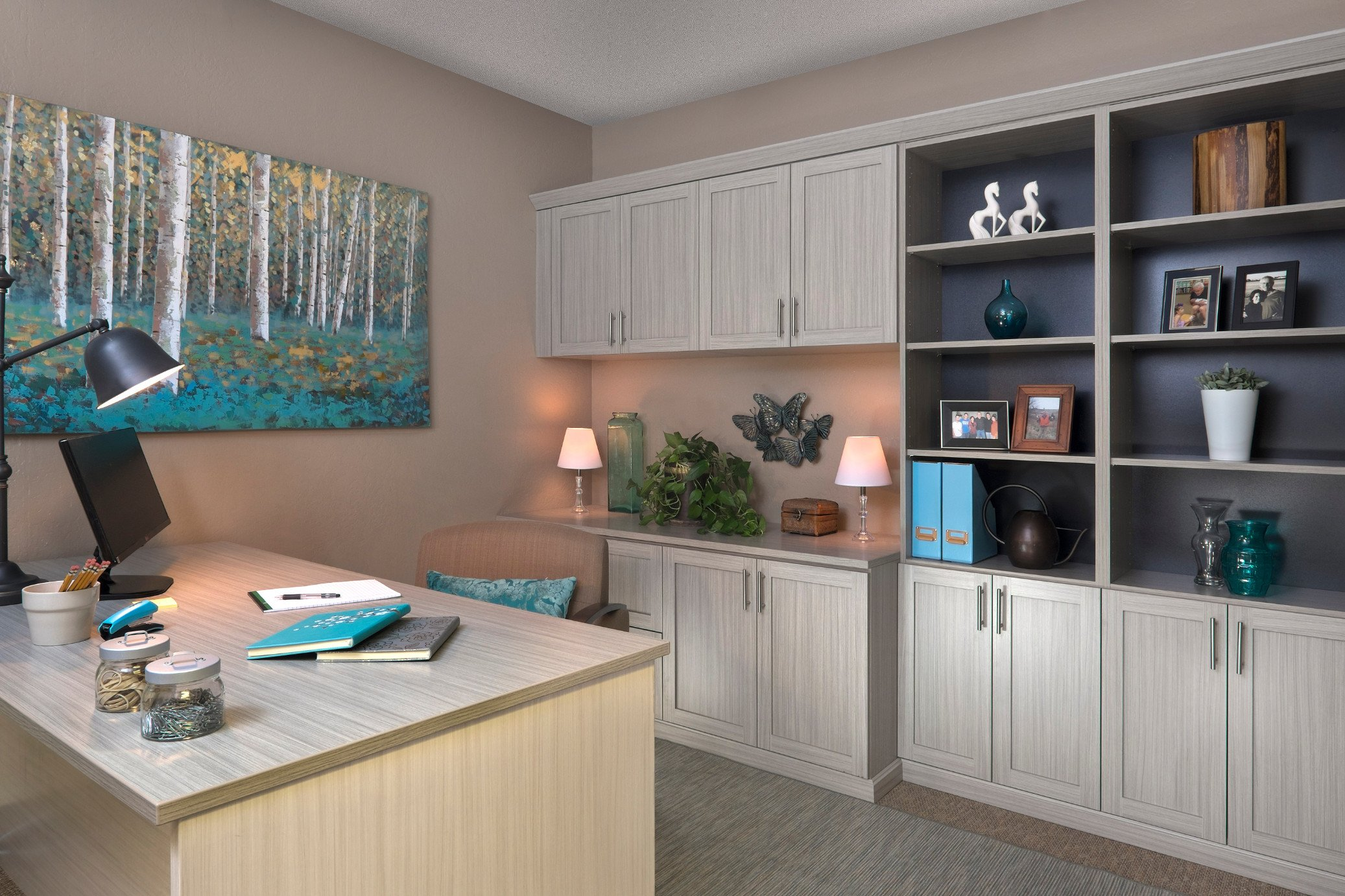 Custom home office with built in cabinets and bookshelves.